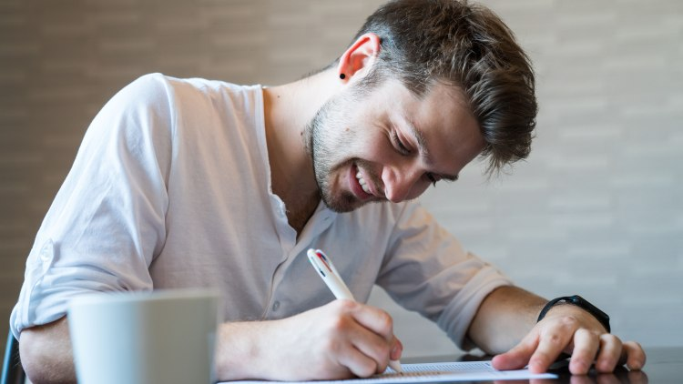 Man filling out important paper documents